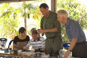 Practice makes perfect: USAID's John Bowman tries a technique for mass-rearing a wasp -- a potential biocontrol against the legume pod borer.