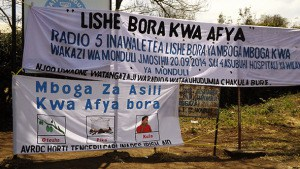 Signs welcoming visitors to Cook Show 2014 at Monduli District Hospital, Tanzania